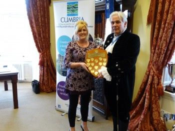Rachel receiving the High Sheriff of Cumbria's Community Shield earlier this year