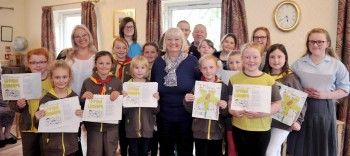 13th Trinity Brownies who are taking part in the time bank, at Risedale Retirement and Residential Home, in Barrow, where they are singing to residents as part of the project. Pictured with them are (back left) Time Bank broker Zoe Hartley and (centre front) Ann Hayes from Barrow Community Trust. Photo courtesy of North West Evening Mail