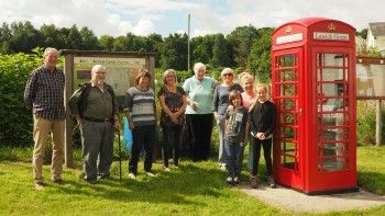 Community members with the completed phone box